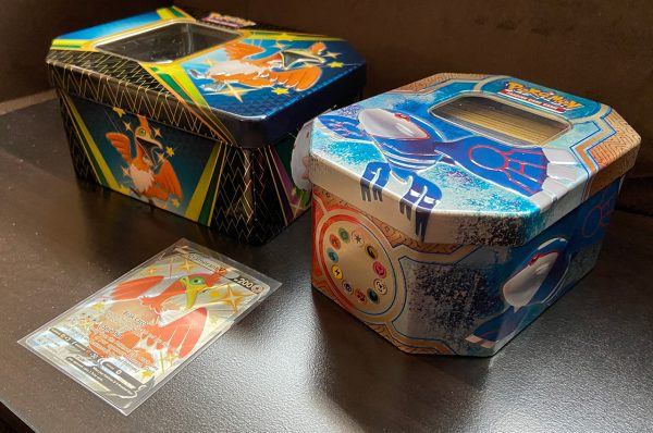 Another view of the Shining Fates Tin compared to an older tin