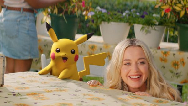 Katy Perry and a female Pikachu looking from a table