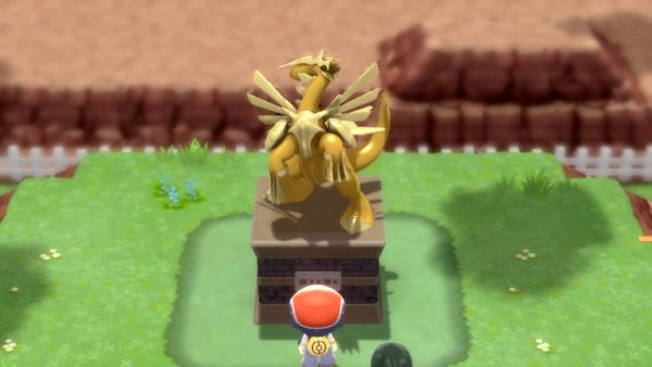 Looking at a statue resembling Dialga and Palkia simultaneously