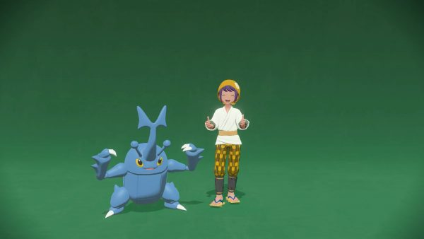 Photo with Heracross and player posing